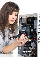 Young woman repairing pc