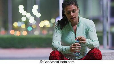 Young woman resting after running - Front view of a fit ...