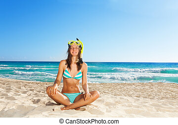 Young woman resting after scuba diving - Young woman resting...
