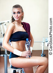 Young woman resting after training
