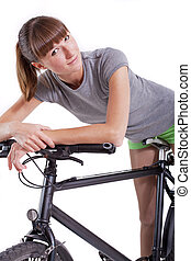 woman resting on her bike