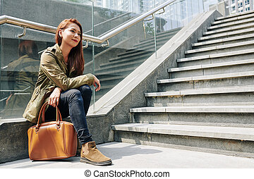 Young woman resting on steps