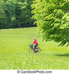 Young woman riding a bicycle.