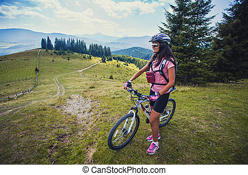 Happy Woman Cyclist Rides In The Forest On A Mountain Bike