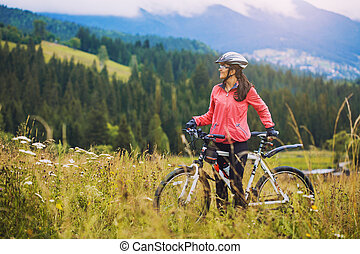 Woman Cyclist Cycling Mountain Bike On Pine Forest Trail