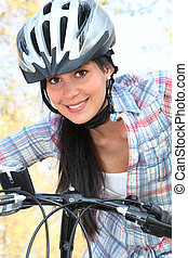 young woman riding bike in the park