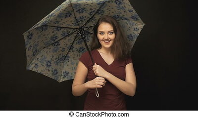 Young woman rotating umbrella