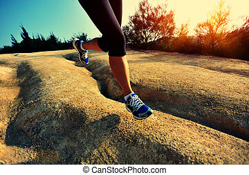 young woman runner legs running on