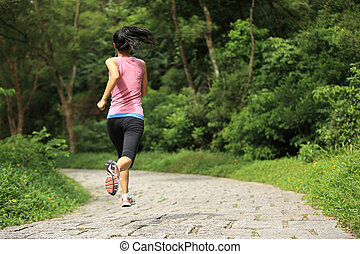 young woman running at forest