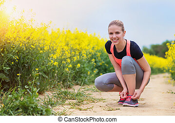 Young woman running - Beautiful young woman running outside...