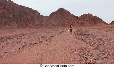 young woman running down - young girl lost in the desert...