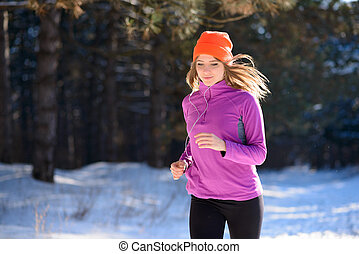 Young Woman Running in Beautiful Winter Forest at Sunny...