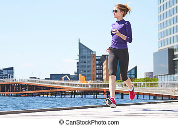 young woman running in Copenhagen