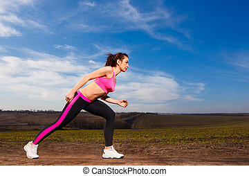young woman running on blue sky background
