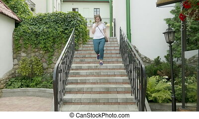 Young woman running on stairs. - Young woman running on...