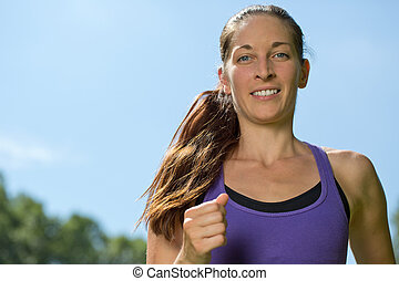 Young woman running or jogging training