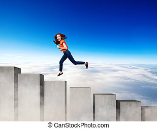 Young woman running up on the stairs blocks.