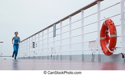 woman runs on deck of cruise ship