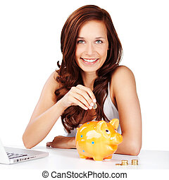 Young woman saving her change in a piggy bank