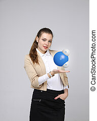 Young woman scientist with model of water molecule.