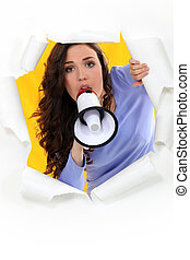 Young woman screaming in a bullhorn