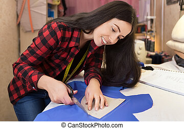 seamstress cutting fabric