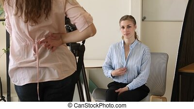 Young woman seducing colleague at work - Woman posing,...