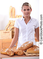 Young woman selling bread