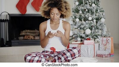 Young woman sending a Christmas message