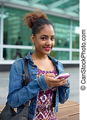 text message - young woman sending a text message