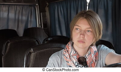 Young woman setas in the bus