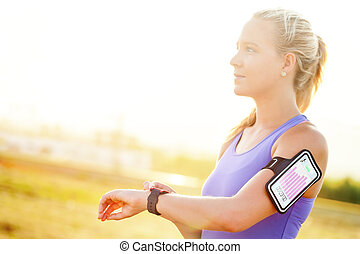 Young woman setting workout on smart watch. - Close up...