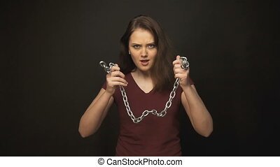 Young woman shaking chain