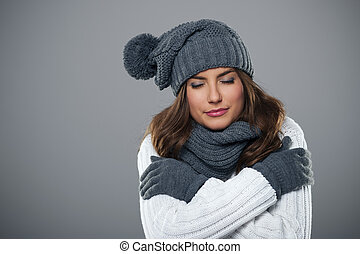 Young woman shivering during the winter season