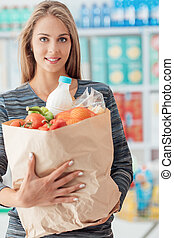 Young woman shopping at the store