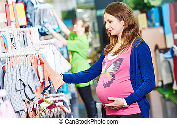 young woman shopping during pregnancy