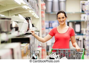 young woman shopping for appliance