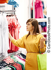 Young woman shopping for clothes