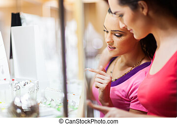 young woman shopping for jewellery