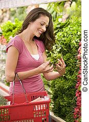 Young woman shopping for produce