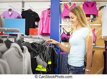 Young woman shopping for sportswear
