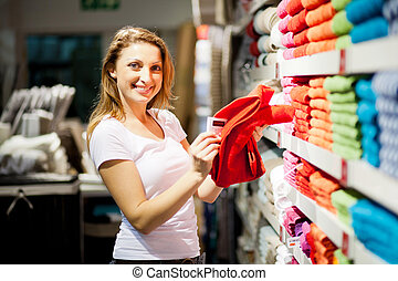 young woman shopping for towels
