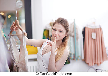 young woman shopping in dress store