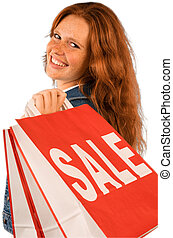 Young woman shopping - Young woman is happy to shop during...