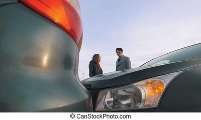 Young woman shouting at man after a car accident