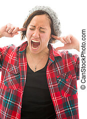 Young woman shouting with fingers in her ears