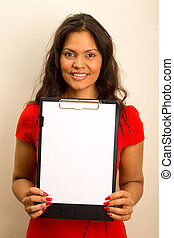 young woman showing a blank clipboard