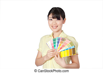 Young Woman Showing Color Chart - Happy young woman showing...
