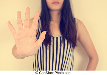 Young woman showing her denial with NO on her hand, vintage...