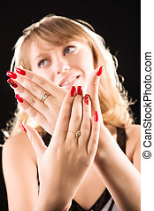 Young woman showing her red nails